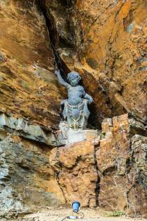 A small statue located in a crevice of the rock work of Portmeirion Villag