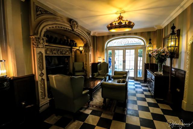 The grand Italian fireplace within the main hall of the Portmeirion Hotel